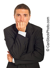 Stressed business man biting his nails isolated on white...