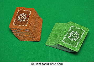 Playing card - pack of playing card on green  casino table