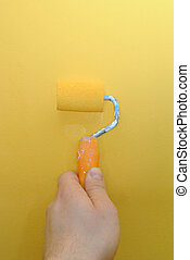 Paint roller - Painting the wall with paint roller