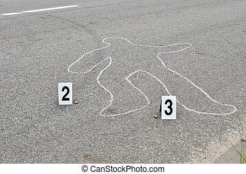 Chalk outline of human body on the street
