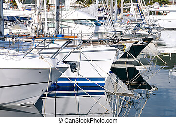 Sailing yachts in marina - Yachts anchored in the luxury...