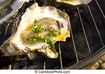 Grilled oyster - Oyster grilling on barbeque with butter and...