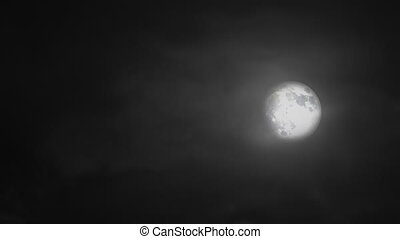 Scary Moon - A night time scene with eerie looking clouds...