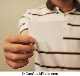 Business Card - Salesman holds up business card - enter your...