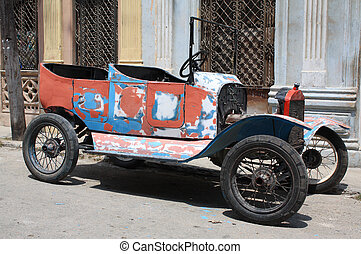 Tattered vintage car in a street of Havana, Cuba - A...