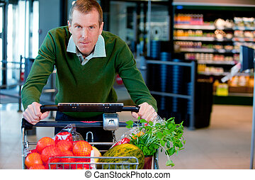 Portrait of a Man in Supermarket - Portrait of a man pushing...
