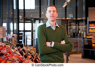 Supermarket Portrait - a portrait of a man in a supermarket