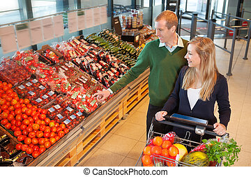 Man pointing at vegetables - Smiling mid adult man pointing...