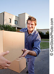 Moving Man - A man passing a moving box to another person