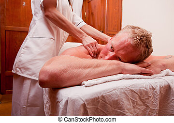 Man Massage Spa - A man receiving a shoulder and back...