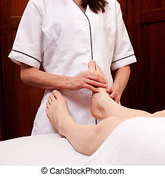 Foot Massage - A woman receiving a foot massage at a spa
