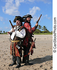 Two Dueling Pirates on the Beach - Two costumed pirates with...