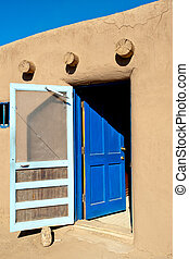 Taos Pueblo - Bright blue door to the room of Taos Pueblo...