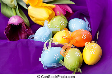 color Easter eggs with tulips