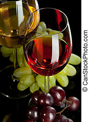 Red and white wine in glasses with grape Top view