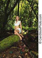 young woman in a forest