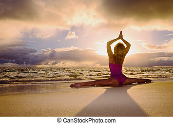 woman doing yoga and stretches - senior woman in her fifties...