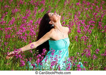 woman on pink flower field close portrait