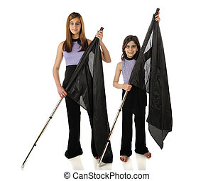 Color Guard - A teen and elementary girl, color guards,...