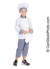 happy little chef - happy little girl in chef uniform studio...