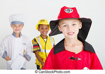 little boy as firefighter, background is kids as chef and...