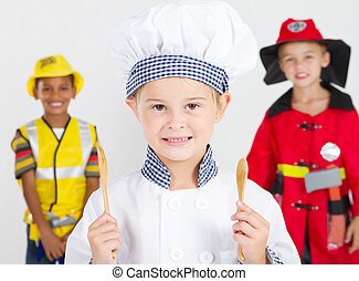 happy little chef in front of construction worker and...