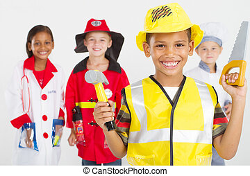 group of little workers in uniforms - group of happy little...