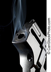 Smoking gun - Snub nosed revolver so hot that smoke is...