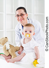 female pediatrician and baby - friendly female pediatrician...