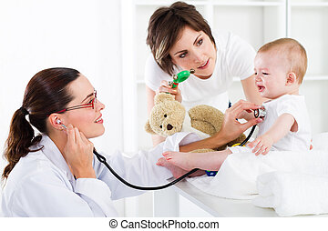 pediatric care - mother and baby in pediatrician office