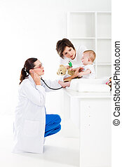pediatrician and patient - mother and baby in pediatrician...