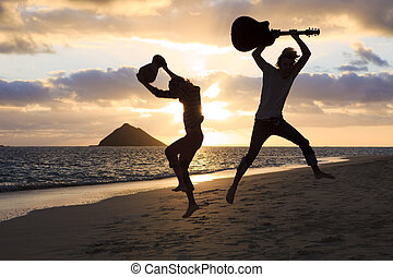 silhouette of twin brothers with drum and guitar leaping in...