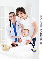 pediatrician room - mother and baby in pediatrician room