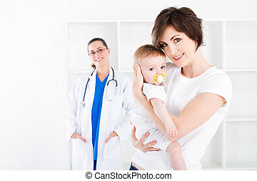 young mother and baby visit doctor - young mother and baby...