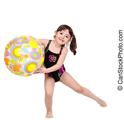 adorabe little girl in swimsuit playing with beach ball...