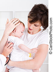 mother taking baby to doctor - caring young mother taking...