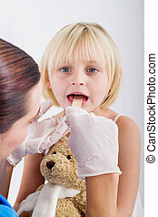 doctor examining little girl - female doctor examining...