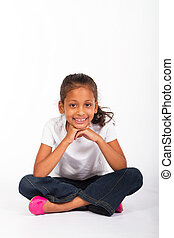 young indian girl sitting on floor