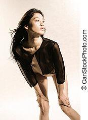 Stunning Asian fashion model in studio