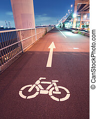 bicycle road - night image of bicycle road going faraway on...