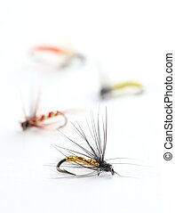 Fishing flies - Close-up of four colorful fishing flies...