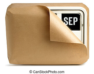 wall clock and calendar wrapped in brown paper isolated on a white background showing September