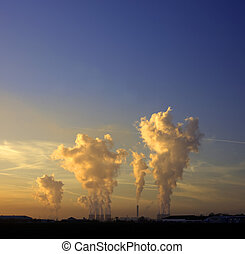 industrial cooling towers at dusk