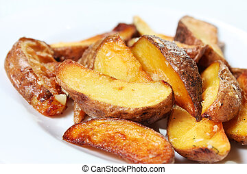 Potato wedges roasted in their skins. Golden and crispy