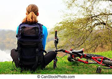 Cyclist on a halt - A woman cyclist on a halt. Travel and...