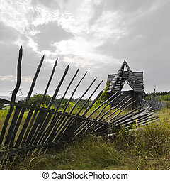 old country house with the fallen fence