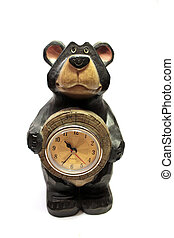 Teddy bear with clock - A teddy bear with clock on the white...