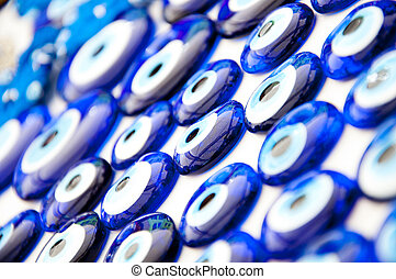 Turkish Evil Eye Beads - Close up texture of many blue glass...