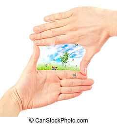 Symbol of the environment - Human hand and nature Symbol of...
