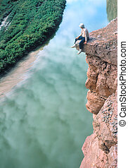 Man on a Ledge - A man is enjoying a view of the Colorado...